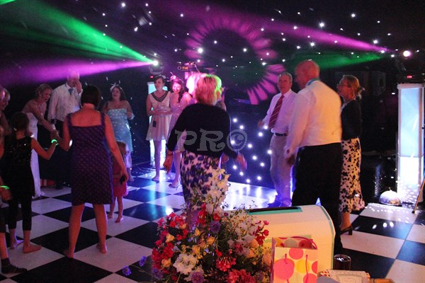 Laura & James wedding in a marquee in Somerset. Amazing decorations for their wedding, with a black LED roof lining. Show 3 was used with surround lighting